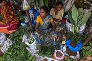 Malik Ghat wholesale flower market lies on the East bank of the Hooghly River below the Howrah Bridge in Calcutta, West Bengal.