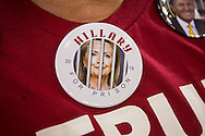 A Donald Trump fan wearing a Hillary for Prison- anti-Hillary Clinton button  at a campaign rally in Baton Rouge, LA, for Republican presidential candidate Donald Trump, before he arrives, on Feb. 11, 2016.