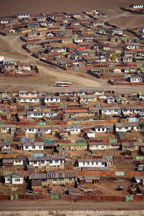 Resident from the rural countryside built squatters houses on the outskirts of Ulaanbaatar, Mongolia. There are some rounded gers visible in the photograph but Mongols attracted to the more modern style began to build non-traditional housing. Architecture. Material World Project.