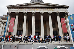 © Licensed to London News Pictures. 11/07/2021. London, UK. England supporters stand on the entrance to The National Gallery in central London  ahead of the final of EURO 2020 at Wembley where England will play Italy. Photo credit: Peter Macdiarmid/LNP