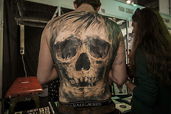 October 5, 2018 - Barcelona, Catalonia, Spain - Man shows his tattoed back with a skull figure in the 21st tattoo and urban culture Expo in Barcelona. (Credit Image: © Celestino Arce Lavin/ZUMA Wire)