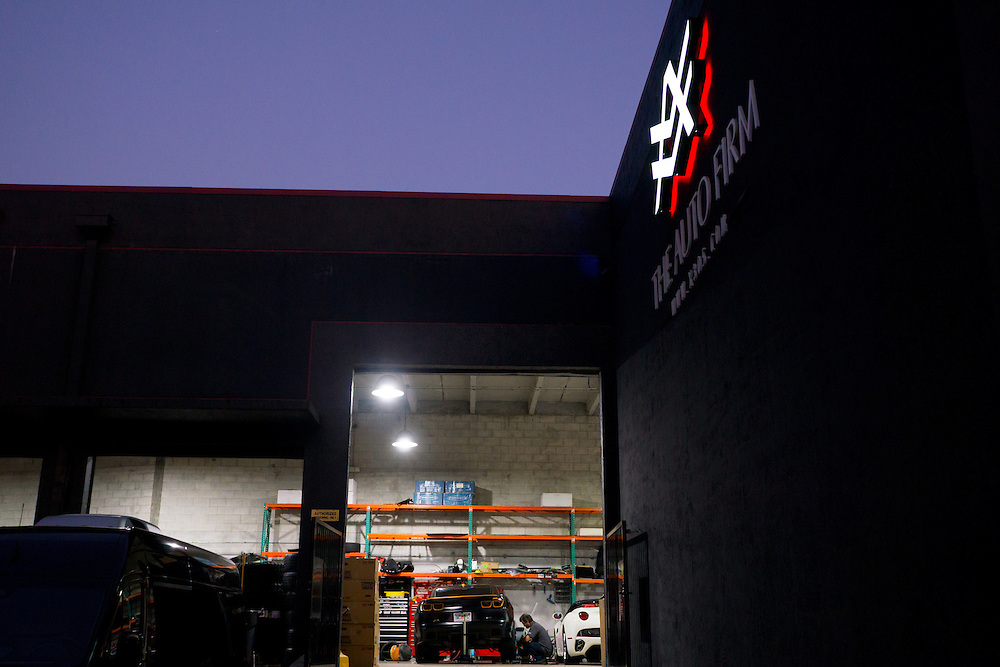 DORAL, FLORIDA, DECEMBER 11, 2015<br /> Sundown as work continues in the garage of  The Auto Firm, a South Florida car customizing and restoring shop which has a vast clientele of professional athletes and entertainers. <br /> (Photo by Angel Valentin/Freelance)