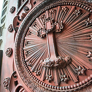 A decorative cast iron door at the Church of Saint John the Baptist at the Béguinage, 17th century Flemish Baroque style Roman Catholic Church in central Brussels, Belgium. It was originally part of the beguinage Notre-Dame de la Vigne.