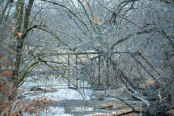 An old steel bridge in disrepair still spans the Kickapoo Creek near Waynesville Illinois