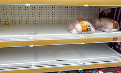 "© Licensed to London News Pictures. 22/12/2020. London, UK. Nearly empty shelves of Christmas turkey in Sainsbury's supermarket in north London as people buy festive groceries and food items, just three days before Christmas day. A number of supermarkets have warned that some items may run low this week. Prime Minister Boris Johnson urged in a press conference for people to ""shop normally"". It came after France closed the borders - banning UK travellers to their country, to stop the spread of the new variant of Covid-19. Photo credit: Dinendra Haria/LNP"