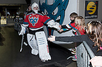 KELOWNA, CANADA - MARCH 18: Jackson Whistle #1 of Kelowna Rockets high fives little fans on his way to the dressing room after warm up against the Seattle Thunderbirds on March 18, 2015 at Prospera Place in Kelowna, British Columbia, Canada.  (Photo by Marissa Baecker/Shoot the Breeze)  *** Local Caption *** Jackson Whistle; fans;