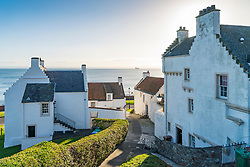 Old whitewashed houses at Hie-Gate in historic village of Dysart in Kirkcaldy , Fife, Scotland, UK