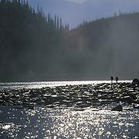 HIKING, Jared Ogden & Scott Backes hike in mist by Nahanni River, Northwest Territories,Canada