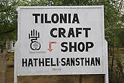 """Tilonia Craft Shop """"Hatheli-Sanstan""""..Barefoot College Tilonia, started by Bunker Roy in the 1970s. An organisation based upon creating economic self-empowerment and sustainable development initiatives, and self-sufficiency, for communities in the rural desert of Rajasthan, India. Energy autonomy with solar power capacitors, parabolic mirrors for cooking, solar powered water heating, and battery lanterns. Freshwater and irrigation through wells and desalination. A multitude of other economic initiatives run by grassroots Indian people, mainly women, where those who participate in, run the projects themselves. Many of them local lower castes, some physically handicapped, most with no paper qualifications, with support from others who gave up high flying money-making careers to be involved in working with poor rural communities. Mico-industries include solar lanterns, electric circuitry and lighting, crafts, textiles, children's toys, and sanitary towels. Also much emphasis on local and oral communications, radio, and puppetry. Now recognised internationally providing an educational resource most often directed towards communities of rural women worldwide."""
