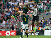 Twickenham, United Kingdom. 3rd June 2018, HSBC London Sevens Series. Game 45. Cup Final.  Fiji vs South Africa. <br /> <br /> Fiji's, Sevuloni MOCENACAGI, challenges, Justin GEDULD, lifted by, Phillip SNYMAN, during the Rugby 7's, match played at the  RFU Stadium, Twickenham, England, <br /> <br /> <br /> <br /> © Peter SPURRIER/Alamy Live News