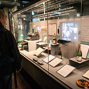 An exhibit commemorating Churchill's love of champagne at the Churchill Museum at the Churchill War Rooms in London. The museum, one of five branches of the Imerial War Museums, preserves the World War II underground command bunker used by British Prime Minister Winston Churchill. Its cramped quarters were constructed from a converting a storage basement in the Treasury Building in Whitehall, London. Being underground, and under an unusually sturdy building, the Cabinet War Rooms were afforded some protection from the bombs falling above during the Blitz.