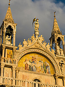 Gold light illuminating an exterior detail of Saint Mark's Basilica, Venice