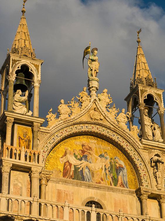 Gold light illuminating an exterior detail of Saint Mark's Basilica, Venice
