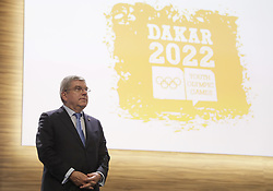BUENOS AIRES, Oct. 9, 2018  President of the International Olympic Committee (IOC) Thomas Bach reacts in front of the first logo of the Dakar Youth Olympic Games 2022 during the 133rd IOC Session in Buenos Aires, capital of Argentina, on Oct. 8, 2018. Senegal was officially confirmed as the host of the 2022 Summer Youth Olympic Games at the IOC Session on Monday.  rtg) (vf) (Credit Image: © Natacha Pisarenko/Xinhua via ZUMA Wire)
