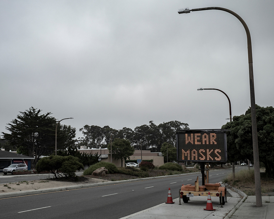 A sign Del Monte Avenue in Monterey, Calif. reminds drivers to wear masks on June 27, 2020.