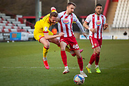 Tackle for the ball with Chris Lines of Stevenage during the EFL Sky Bet League 2 match between Stevenage and Walsall at the Lamex Stadium, Stevenage, England on 20 February 2021.