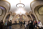 Moscow, Russia, 21/01/2011..The Moscow Metro underground transport system, renowned for its' spectacular Soviet architecture: passengers, mosaics and stain glass windows at Novoslobodskaya station.