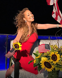 """Mariah Carey releases a photo on Instagram with the following caption: """"Happy Fourth of July!!!!! \ud83c\uddfa\ud83c\uddf8\ud83c\udf3b"""". Photo Credit: Instagram *** No USA Distribution *** For Editorial Use Only *** Not to be Published in Books or Photo Books ***  Please note: Fees charged by the agency are for the agency's services only, and do not, nor are they intended to, convey to the user any ownership of Copyright or License in the material. The agency does not claim any ownership including but not limited to Copyright or License in the attached material. By publishing this material you expressly agree to indemnify and to hold the agency and its directors, shareholders and employees harmless from any loss, claims, damages, demands, expenses (including legal fees), or any causes of action or allegation against the agency arising out of or connected in any way with publication of the material."""