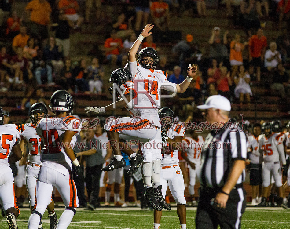 Traevon Edmundson (#5) celebrates a Tigers touchdown with his quarterback Cade Horton (#14)