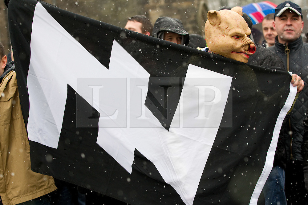 """© licensed to London News Pictures. Rochdale, UK  04/02/2012. The """"North West Infidels"""", a Nationalist group splintered from the EDL; protest outside Rochdale Town Hall. About 150 turned out, many from Scotland. They shouted Nationalist, Islamophobic and anti-Zionist slogans and listed to speeches. Some gave Nazi salutes. Photo credit should read Joel Goodman/LNP"""