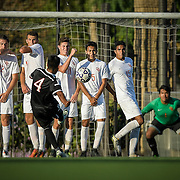 Freshman forward Derian Lopez takes a free kick in the second half of a game between Santa Ana College and Orange Coast College in Santa Ana, CA on November 4, 2016.