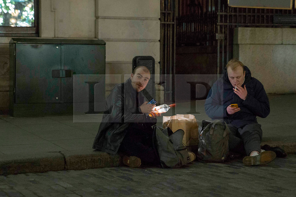 © Licensed to London News Pictures.31/12/2020, London, UK. Members of the public marking the end of the year in central London, drinking in the streets as three quarters of England plunged into Tier 4 last night. This New Year's Eve Londoners need to stay at home according to Tier 4 guidelines. Photo credit: Marcin Nowak/LNP