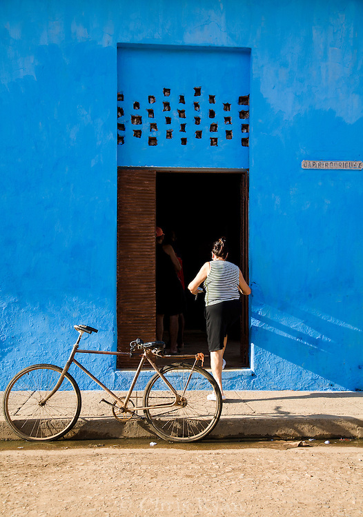 Bicycle in front of blue building, Remedios, Cuba