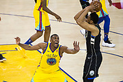 Golden State Warriors forward Kevon Looney (5) reacts to a Milwaukee Bucks jump shot at Oracle Arena in Oakland, Calif., on March 29, 2018. (Stan Olszewski/Special to S.F. Examiner)