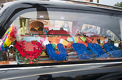 © Licensed to London News Pictures. 05/02/2021. Reading, UK. Flowers and Haribo sweets in the hearse as the funeral procession carrying the coffin of teenager Olly Stephens arrives at Reading Crematorium. 13-year-old Oliver Stephens, known as Olly, was killed in a stabbing at Bugs Bottom fields in Emmer Green on the 3rd of January. Photo credit: Ben Cawthra/LNP