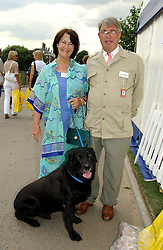 TOBY & EIRA JESSEL and their dog Buller at the Macmillan Cancer Relief Dog Day held at the Royal Hospital Chelsea South Grounds, London on 6th July 2004.