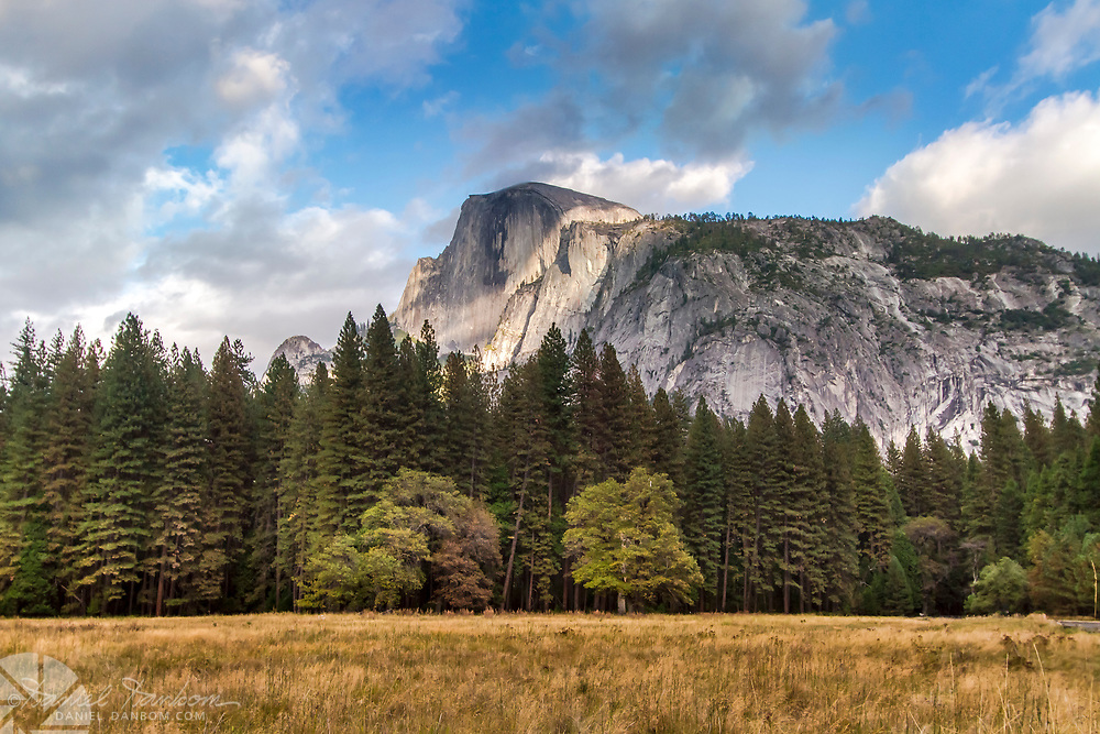 View of Half Dome, Yosemite National Park, looking across the fall colors meadow.