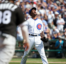 July 25, 2017 - Chicago,Illinois, U.S. - Chicago Cubs relief pitcher CARL EDWARDS JR. celebrates after striking out the Chicago White Sox's Jose Abreu, not pictured, with two runners on base to end the top of the sixth inning on Tuesday at Wrigley Field. The Cubs won, 7-2. (Credit Image: © Brian Cassella/TNS via ZUMA Wire)