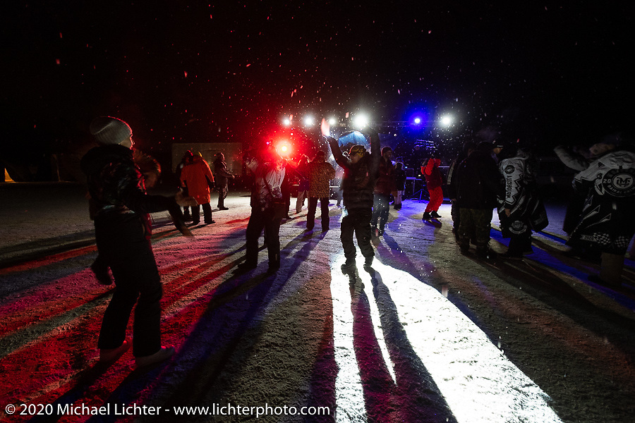 Dancing (in 6 degree F/ -14.5 C weather) on Lake Baikal at the wrap party after the close of the Baikal Mile Ice Speed Festival. Maksimiha, Siberia, Russia. Saturday, February 29, 2020. Photography ©2020 Michael Lichter.