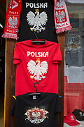 A detail of Polish T-shirts, scarves and baseball caps featuring the White eagle, Poland's national symbol, outside a shop on Krupowki Street, on 16th September 2019, in Zakopane, Malopolska, Poland.