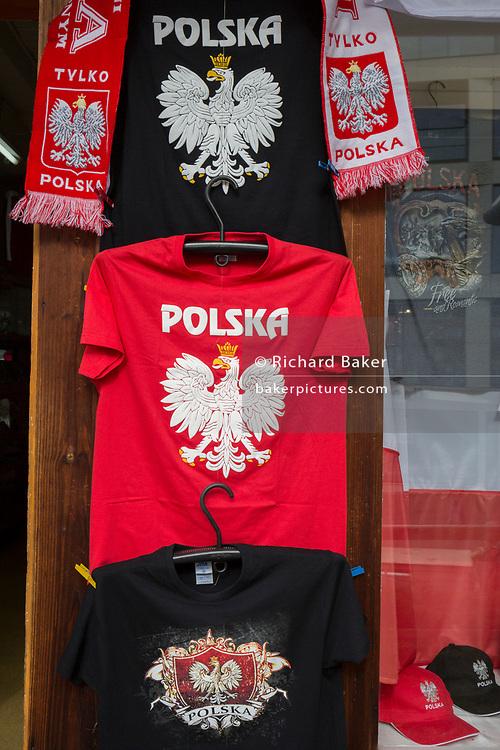 A detail of Polish T-shirts, scarves and baseball caps featuring the White eagle, Poland's national symbol, outside a shop on Krupowki Street, on 16th September 2019, in Zakopane, Malopolska, Poland.