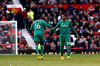 Football - 2018 / 2019 Premier League - Manchester United vs. Watford<br /> <br /> Etienne Capoue of Watford congraluates Abdoulaye Doucoure after his late goal, at Old Trafford.<br /> <br /> COLORSPORT/ALAN MARTIN