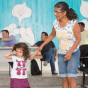 CAPTION: Rosana's mother was not at all apprehensive about her daughter choosing to raise her child singlehandedly. She was confident she could play an active role as a grandparent, and that her daughter would therefore have all the help she needed with raising her child. LOCATION: Hospital Geral de Benjamin Constant, Rua 13 de Maio, 1496, Benjamin Constant, Amazonas, Brazil. INDIVIDUAL(S) PHOTOGRAPHED: Maria Souza (left) and Maria Souza (right).