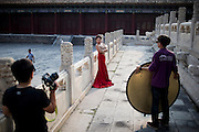 "A Chinese bride poses for a picture during her wedding photo-book shooting in the Forbidden City of Beijing, China, July 19, 2014.<br />   <br /> This picture is part of the series ""Urban Chinese Streets"", a journey on the streets of Chinese cities to discover their modern citizens and habits.      <br /> <br /> © Giorgio Perottino"