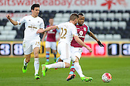 Aston Villa's Jordan Ayew (19) takes on the Swansea defence. Barclays Premier league match, Swansea city v Aston Villa at the Liberty Stadium in Swansea, South Wales on Saturday 19th March 2016.<br /> pic by  Carl Robertson, Andrew Orchard sports photography.