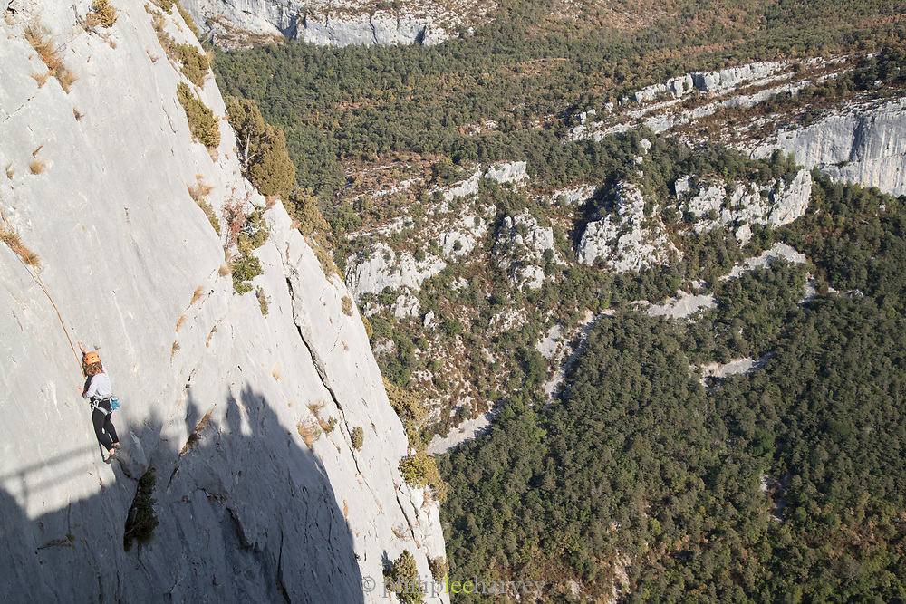 Rock climber on steep mountain side in Gorges du Verdon, Verdon Natural Regional Park, France