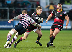 Dragons' Angus O'Brien evades the tackle of  Cardiff Blues' Damian Welch<br /> <br /> Photographer Simon King/Replay Images<br /> <br /> Guinness Pro14 Round 11 - Dragons v Cardiff Blues - Tuesday 26th December 2017 - Rodney Parade - Newport<br /> <br /> World Copyright © 2017 Replay Images. All rights reserved. info@replayimages.co.uk - www.replayimages.co.uk