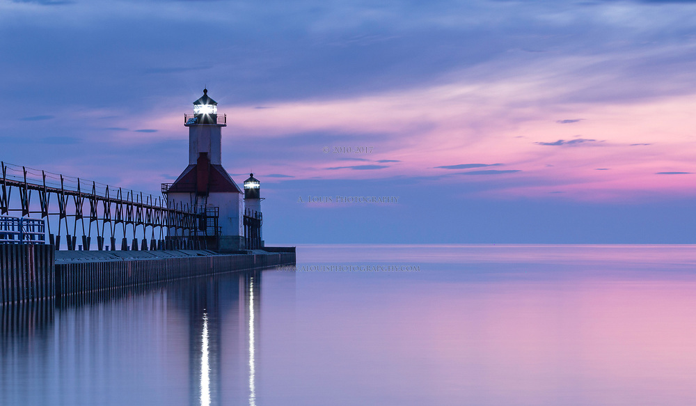 A serene sunset on Lake Michigan of the St. Joseph lighthouse