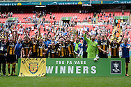 Morpeth Town players celebrate with the trophy having won the FA Vase match between Hereford FC  and Morpeth Town at Wembley Stadium, London, England on 22 May 2016. Photo by Dennis Goodwin.