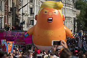 The Baby Trump balloon makes its way up Whitehall during the protest in central London against the visit of US President Donald Trump to the UK, on 13th July 2018, in London, England.