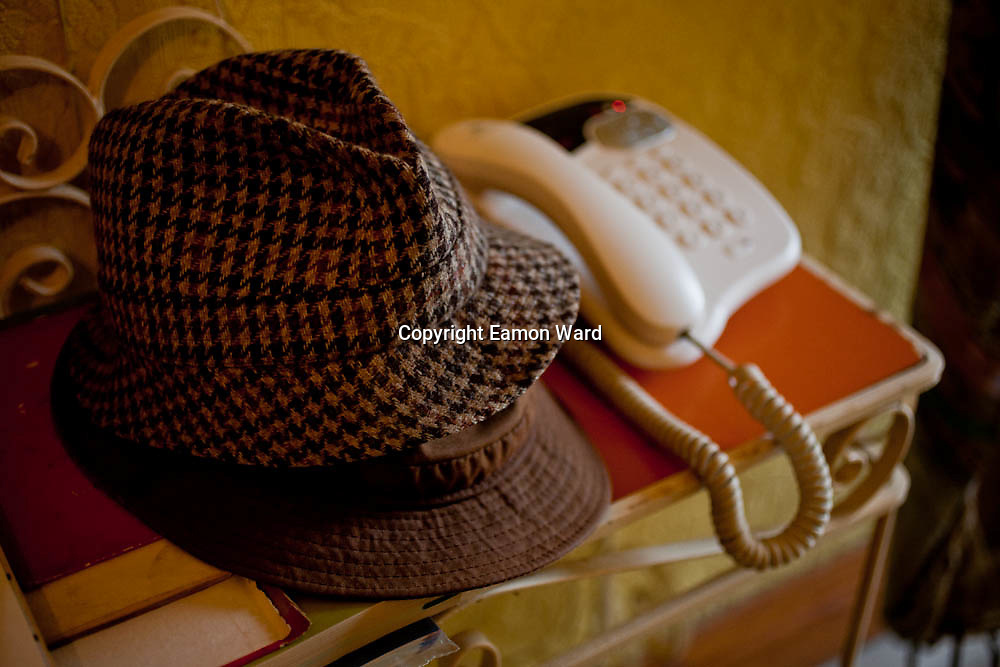 Hats and Phone. Things as they were in my Uncle's house in the days of his passing, before time could alter.