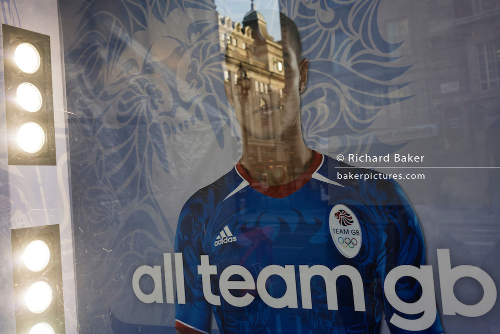 An unidentified athlete featured in Lillywhites window with reference to team GB sponsor Adidas whose logo is on the man's shirt.