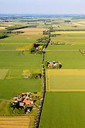 Nederland,  Land van Maas en Waal, Gelderland, 27-05-2013; West Maas en Waal, oorspronkelijk een gebied van komgronden (laaggelegen en nat gebied), versnipperd en slecht ontsloten. Foto langs een van Nederlands bekendste boerderijstraten Kooiweg-Papesteeg-Liesbroekstraat-Hoogbroekstraat.<br /> Grootschalige ruilverkaveling in combinatie met cultuurtechnische gebiedsverbetering is in de jaren vijftig (jaren '50) van de vorige eeuws gecombineerd met voorlichting en scholing van de bewoners.<br /> The low and wet land between the rivers Maas and Waal, central Netherlands  has been developed in the fifties by large-scale land consolidation and education, development and training of the residents. One of the main roads along the farms.luchtfoto (toeslag op standard tarieven)<br /> aerial photo (additional fee required)<br /> copyright foto/photo Siebe Swart