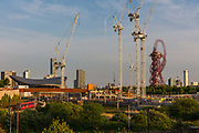Queen Elizabeth Olympic Park which houses West Ham United soccer stadium during the coronavirus pandemic on the 7th May 2020 in London, United Kingdom. The Olympic sports venues nearby include the London Stadium, and Lee Valley Velopark. In the distance is, Standing at 114.5m tall, the red steel ArcelorMittal Orbit by Anish Kapoor. UKs largest sculpture.
