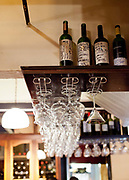 Wine glasses and wine bottles in Don Julio Parilla, a famous steak house in Palermo, Buenos Aires, Federal District, Argentina.