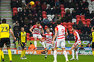 Andrew Butler of Doncaster Rovers (6) heads the ball defensively during the EFL Sky Bet League 1 match between Doncaster Rovers and Scunthorpe United at the Keepmoat Stadium, Doncaster, England on 15 December 2018.
